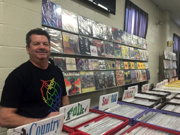 Tom Konopka from Rochester, NY shows off his booth of extensive music offerings.