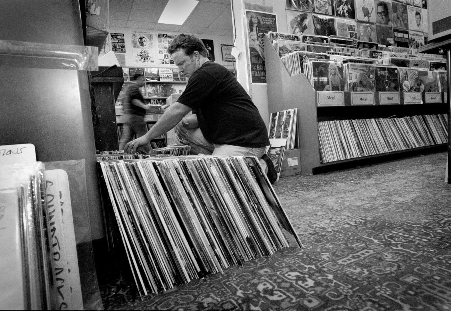 Mark Baily goes through albums at Yesterday & Today, the Rockville, Md., record store that Skip Groff opened in 1978. (Robert A. Reeder:The Washington Post).jpg