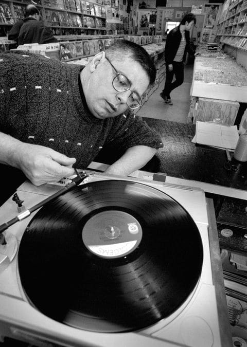 Mr. Groff in 1997, cuing up a record at his store in Rockville. (Robert A. Reeder:The Washington Post).jpg